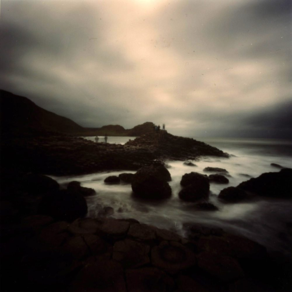"""Dianne Bos, """"Tourists on Giants Causeway, Ireland"""", 2010, CPrint - Newzones Gallery, Calgary"""
